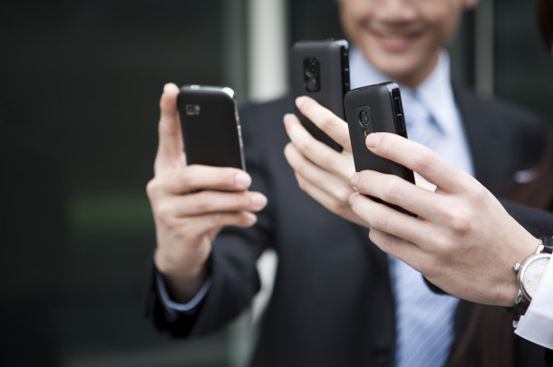 Close-up of human hands holding mobile phone