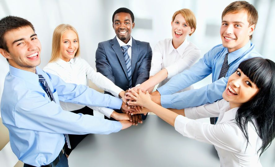 42150246 - business team showing unity with their hands together